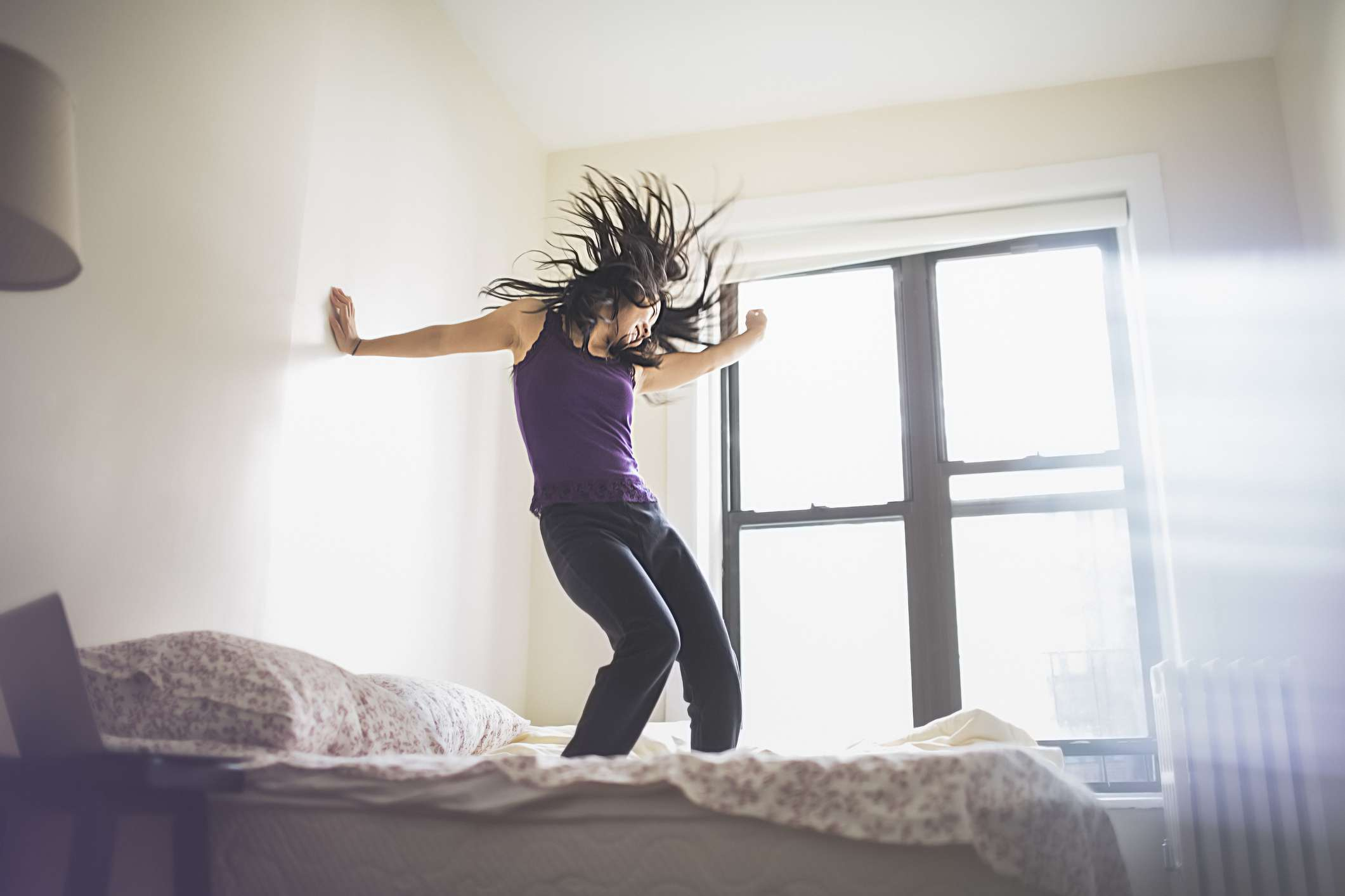 woman dancing in bed