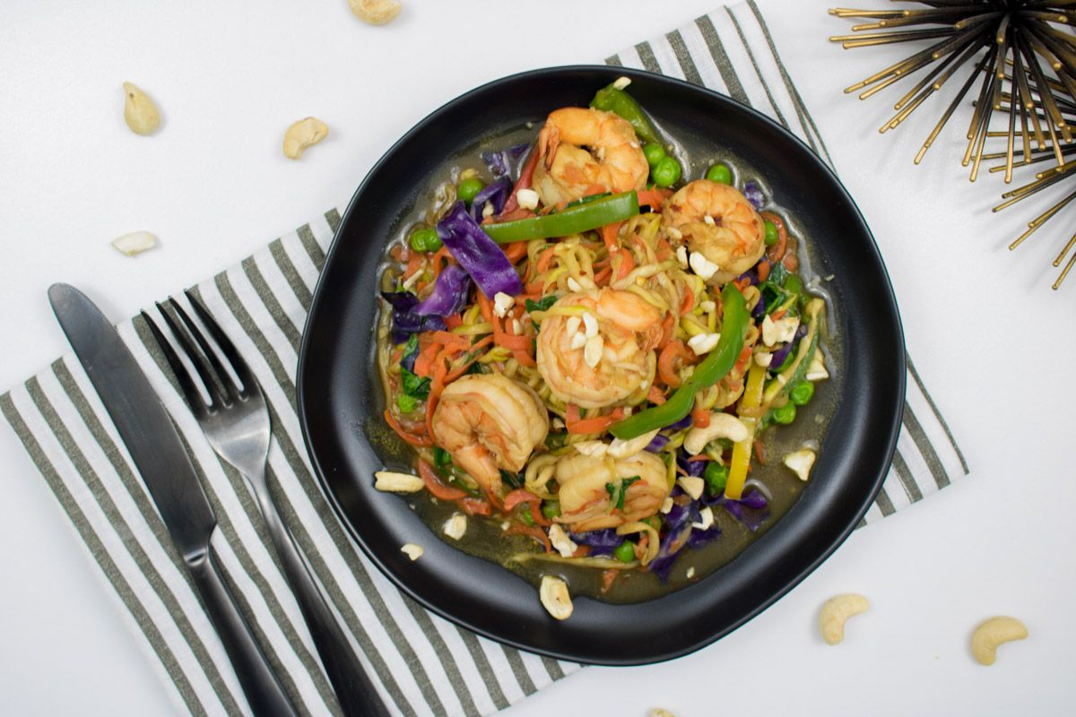 Carrot and zucchini noodles stir fry with shrimp