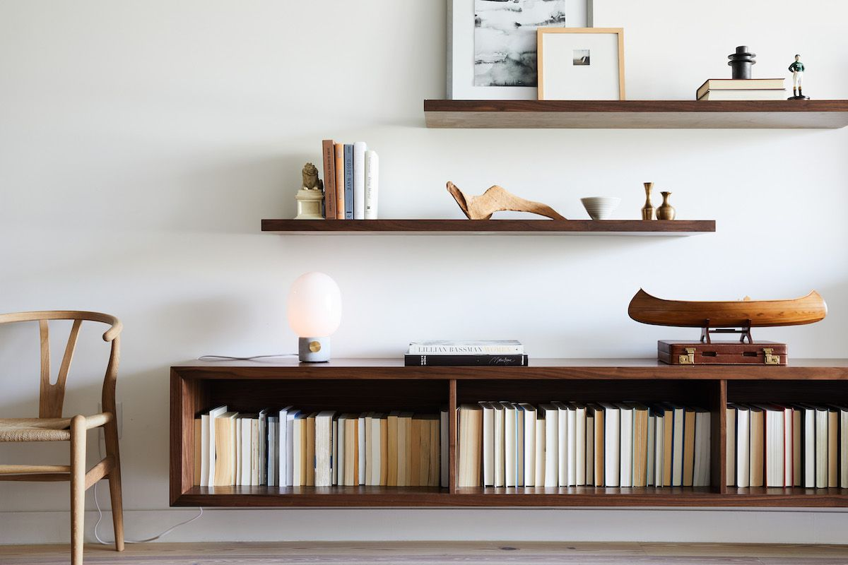A wall lined with staggered wooden shelves