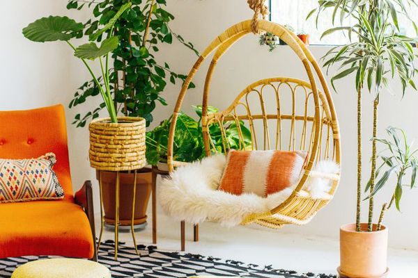 Bohemian living room with hanging rattan swing chair