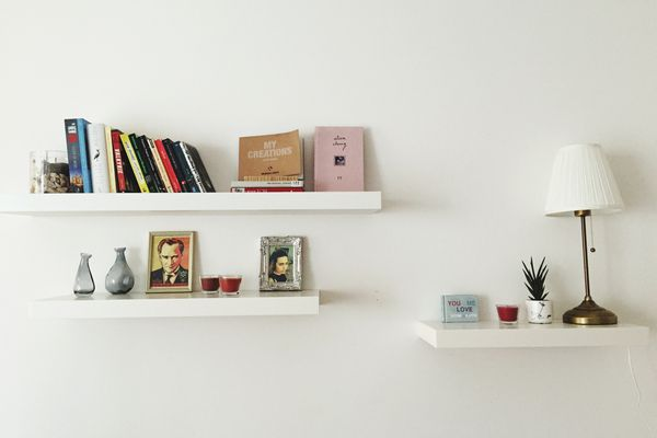 white wall with bookshelves