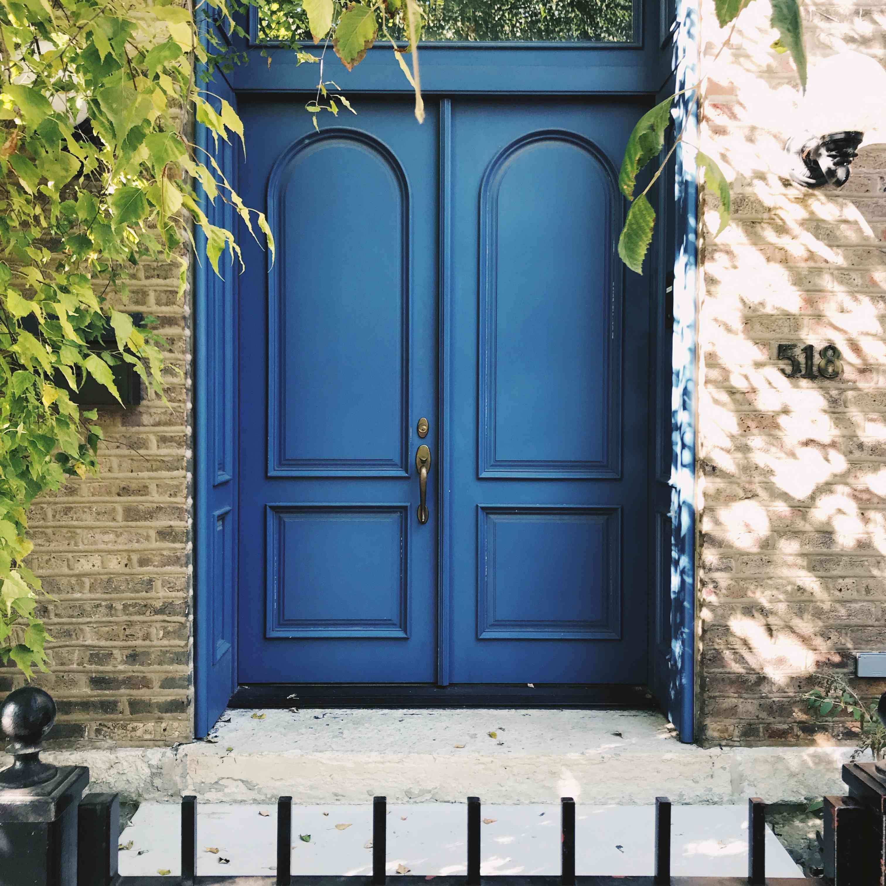 Blue doors accentuate a townhome