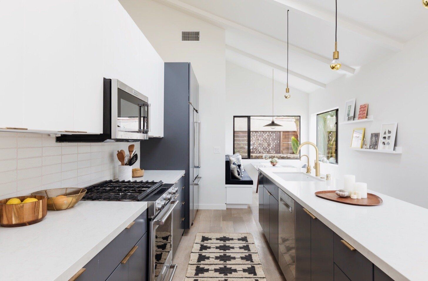 All white kitchen with slanted ceiling, gray-blue cabinetry