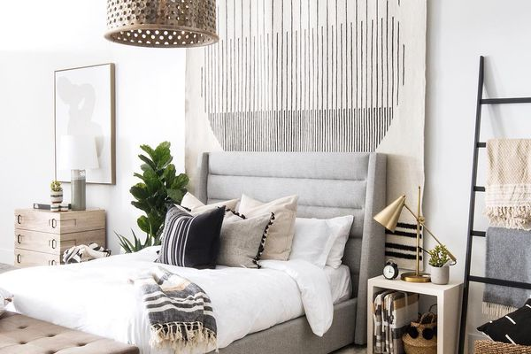 bedroom with a hanging rug