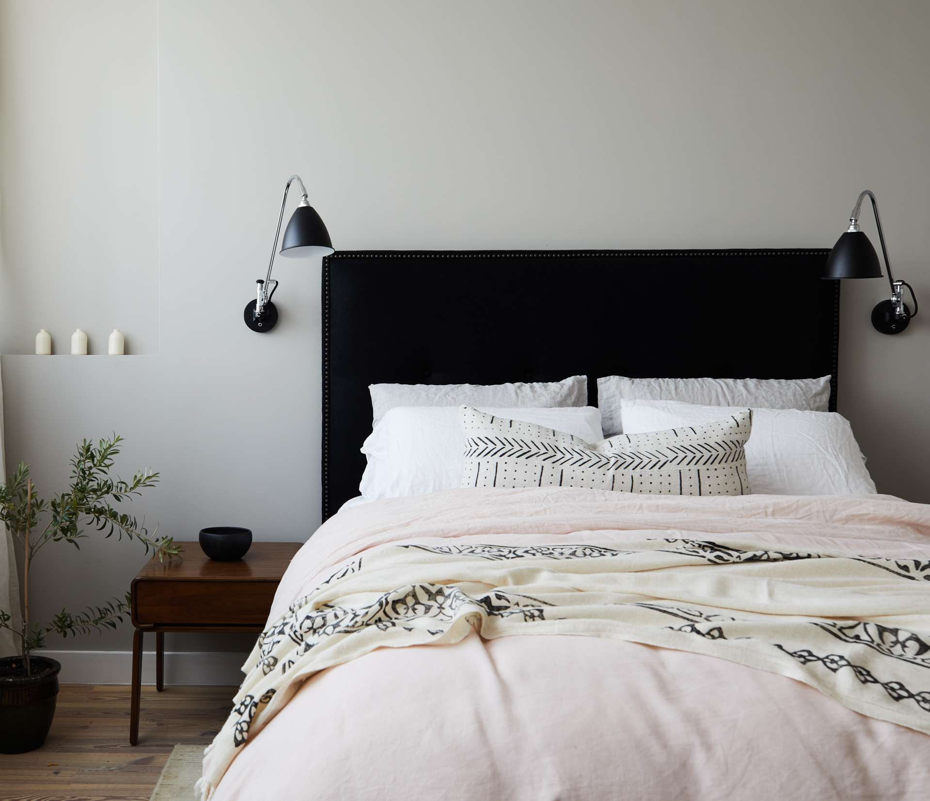 bedroom with contrasting colors, white and black and pale pink