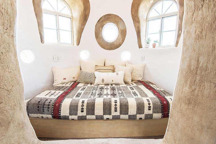 a SuperAdobe home bedroom
