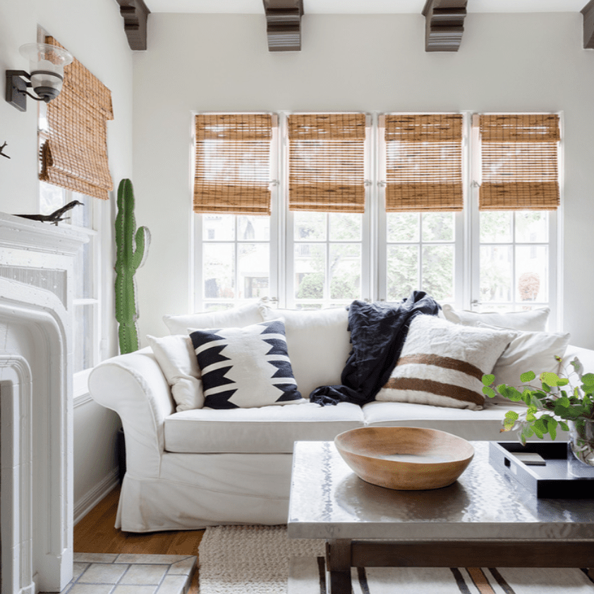 Living room with exposed wood beam ceiling, striped area rug