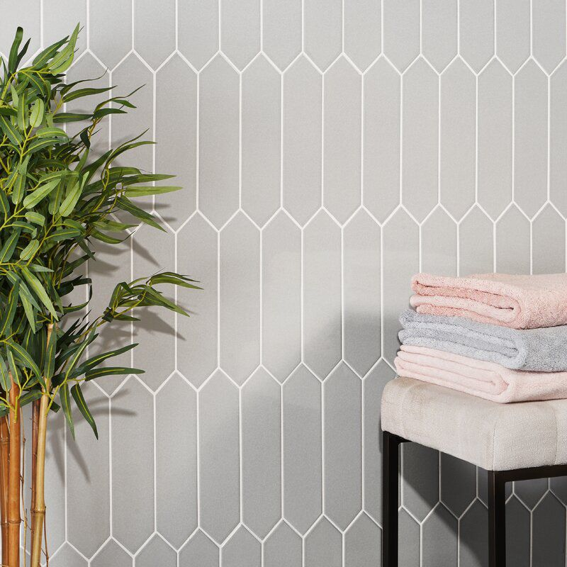 A set of gray hexagonal tiles, which you can buy at Wayfair