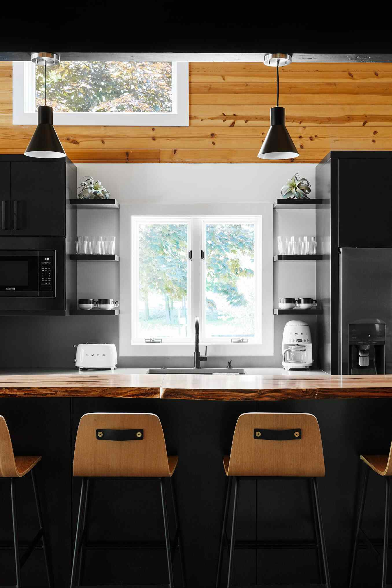 A modern rustic kitchen filled with wood and black metal accents