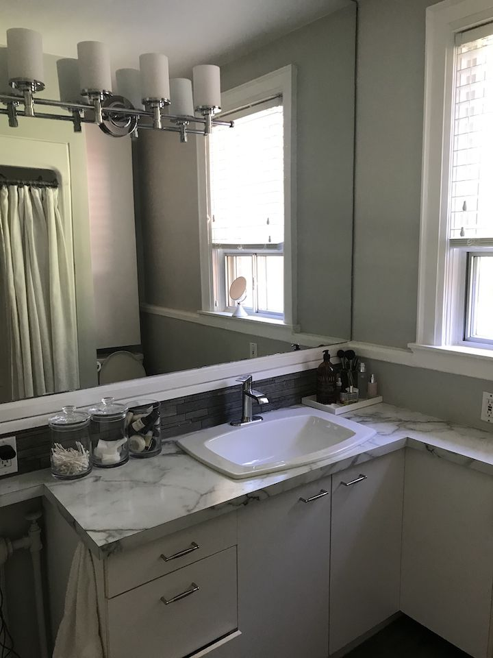 Outdated bathroom with marble countertop.