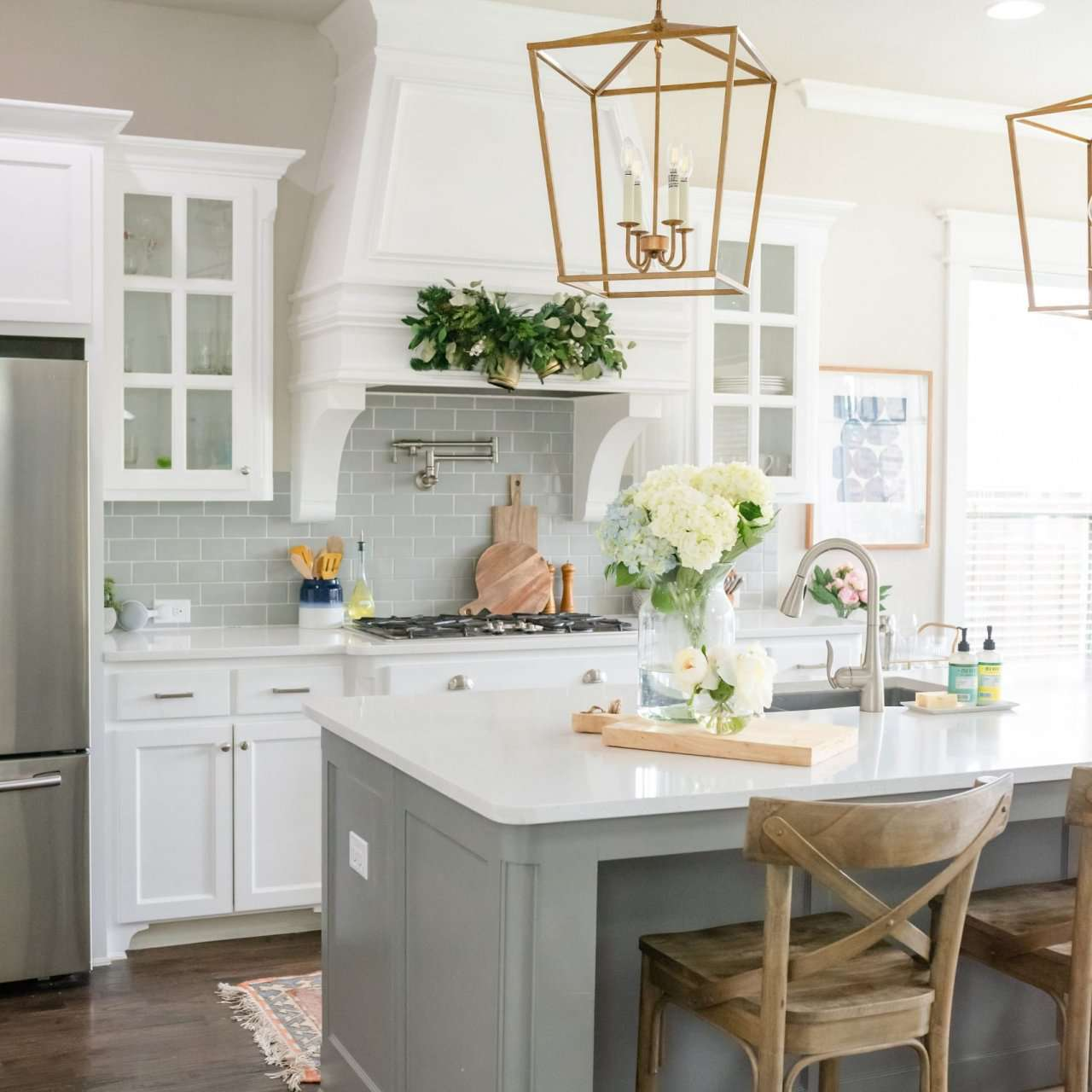 Traditional kitchen with oversized brass lantern pendant over island