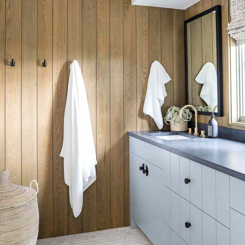 A wood-paneled bathroom