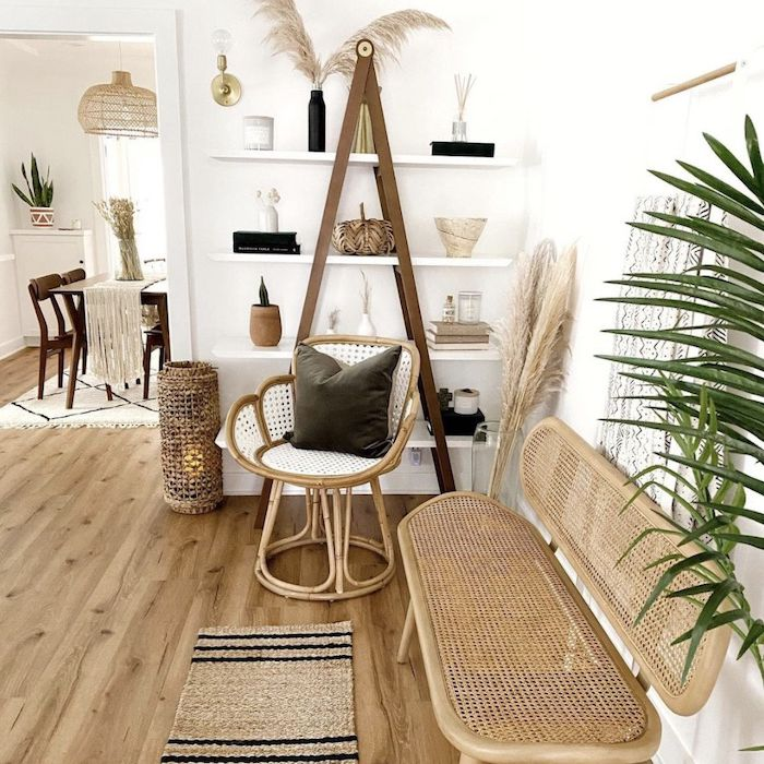boho inspired entryway space with built in shelf and wicker furniture