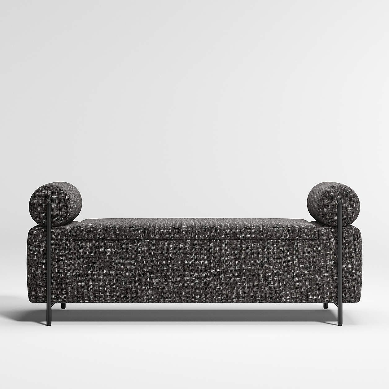 A cushioned bench that doubles as a storage space, which is currently for sale at Crate & Barrel