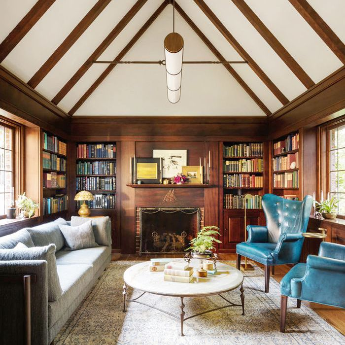 a living room with vaulted ceiling