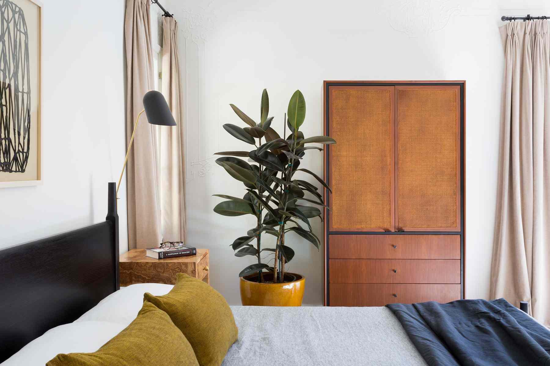 Bedroom with window treatments