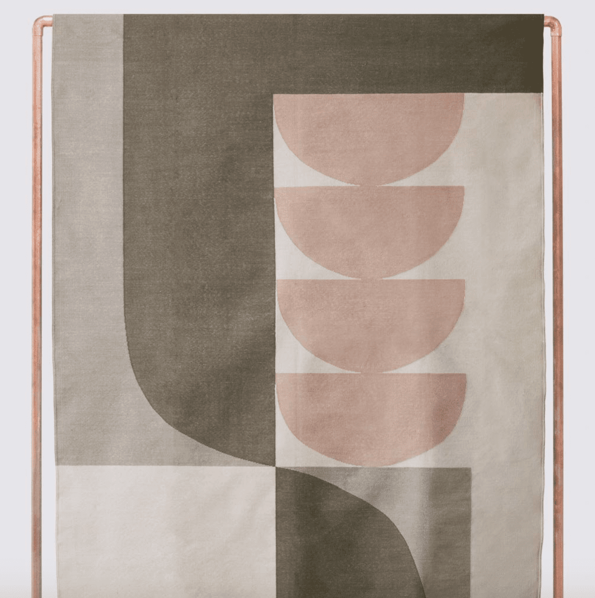 patterned rug in shades of olive and blush pinkl