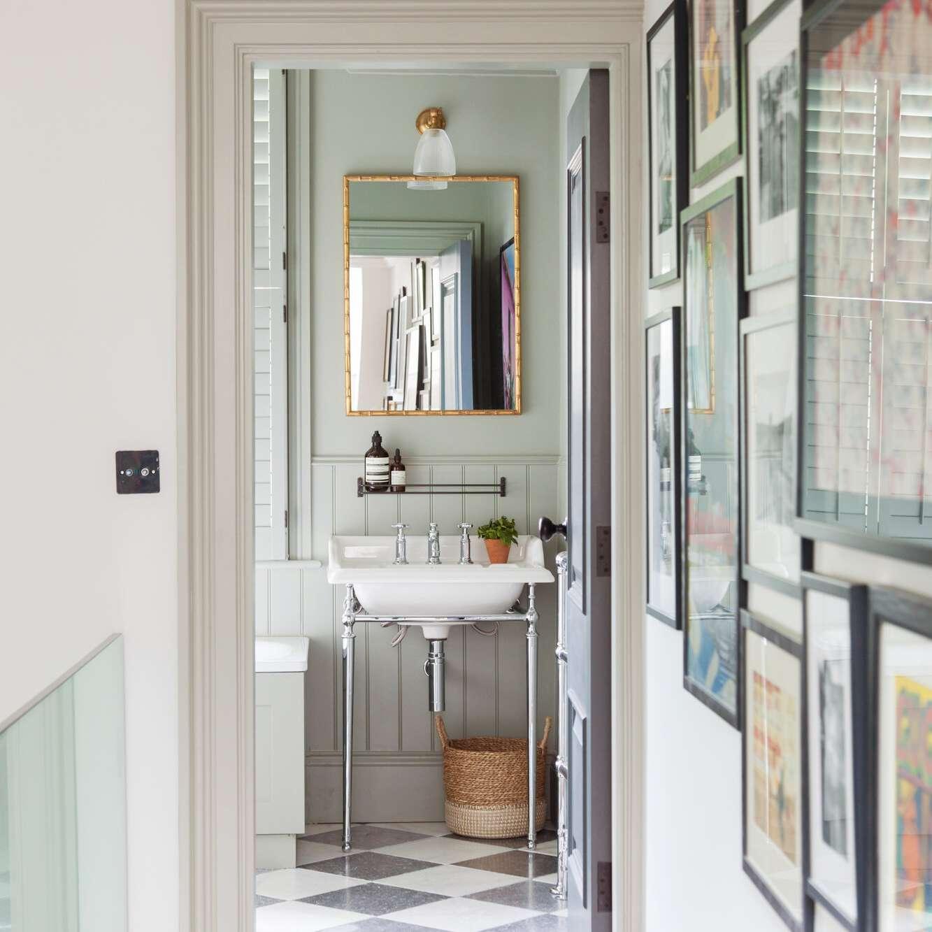 A mint bathroom, viewed from a hallway