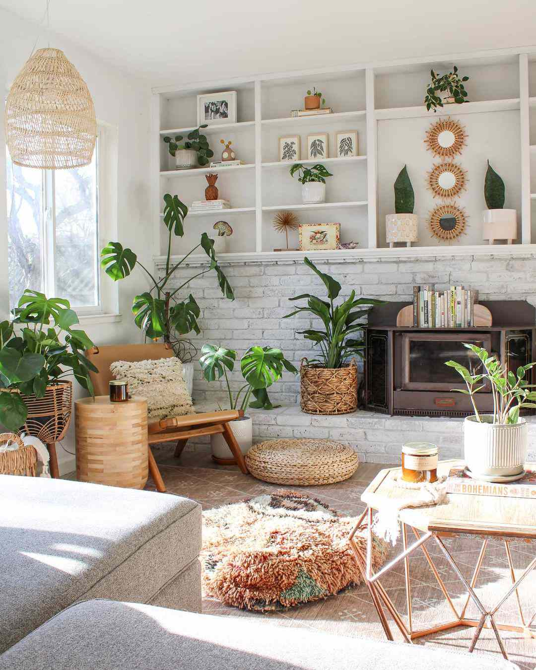 Tropical boho living room filled with plants.