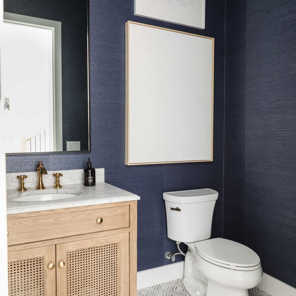 A bathroom lined with indigo wallpaper