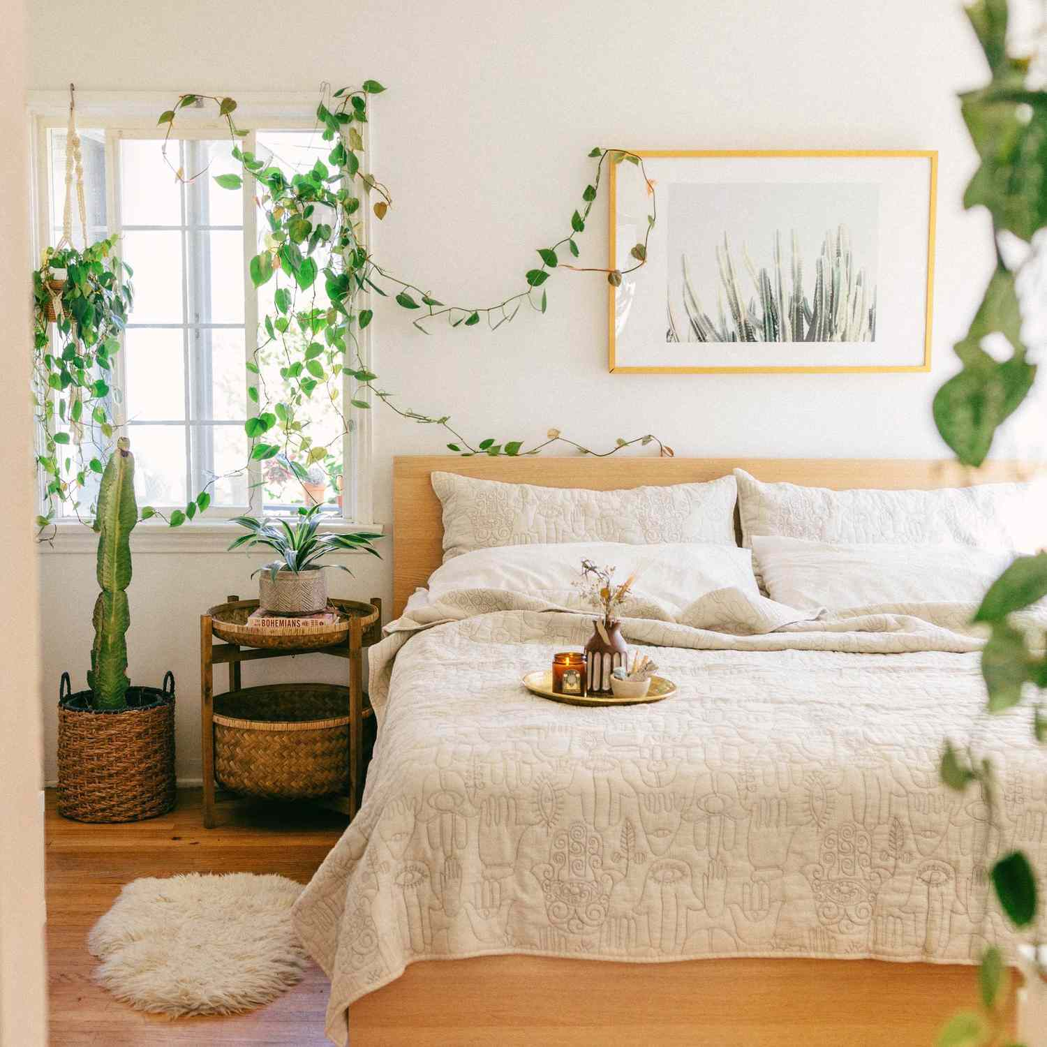 Bright and airy boho chic bedroom with plants