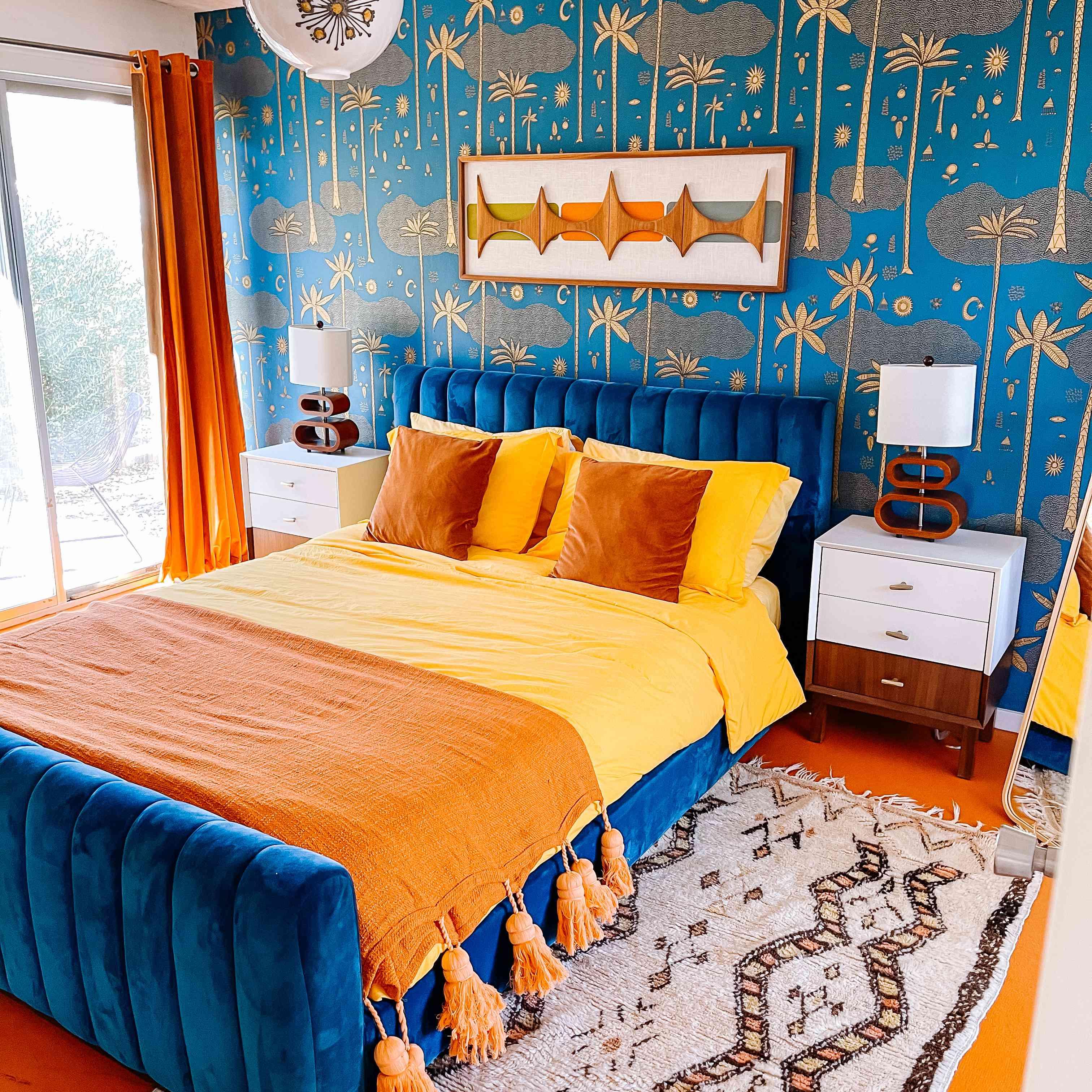 Blue bedroom with velvet headboard.