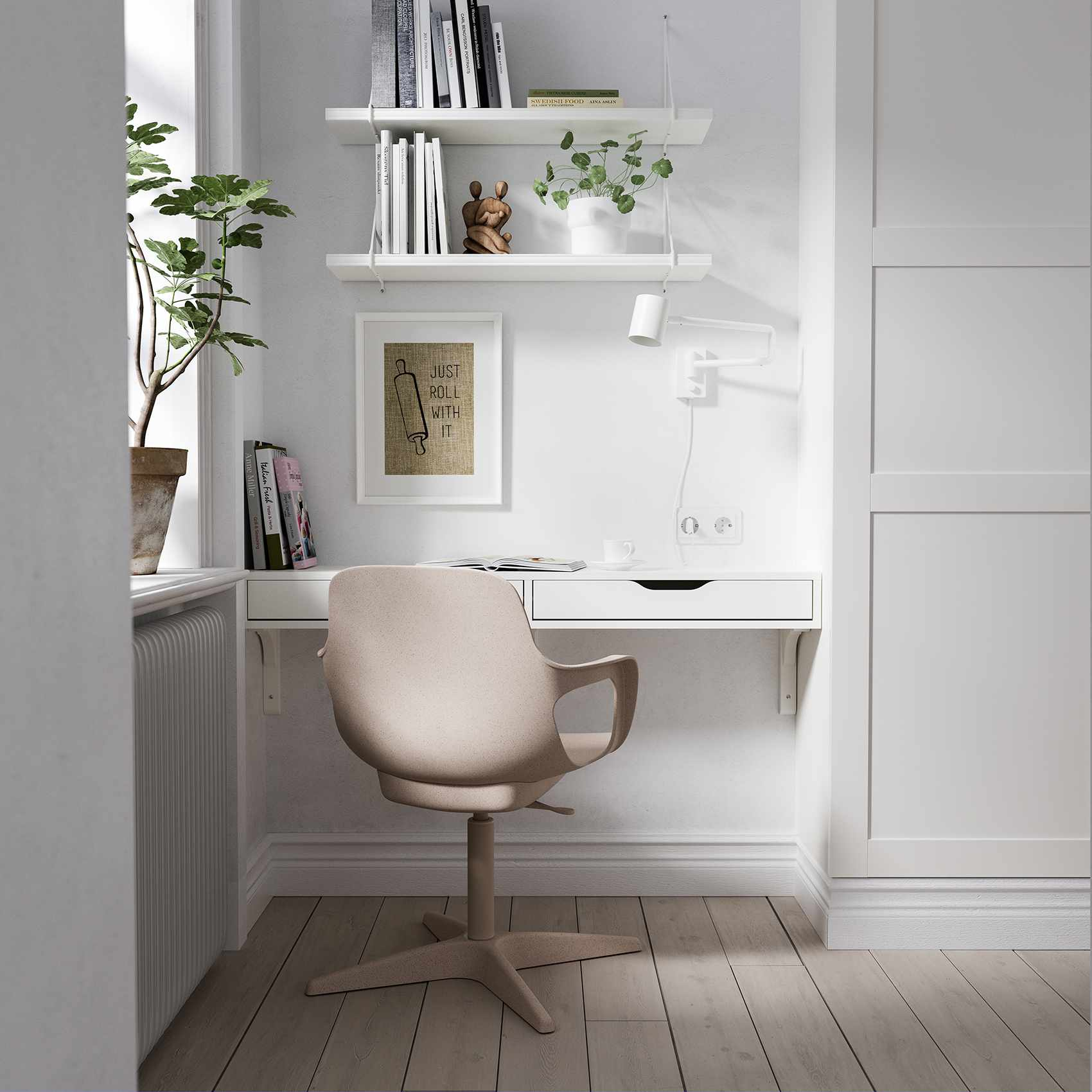 wall mounted desk with blush pink chair in a home office