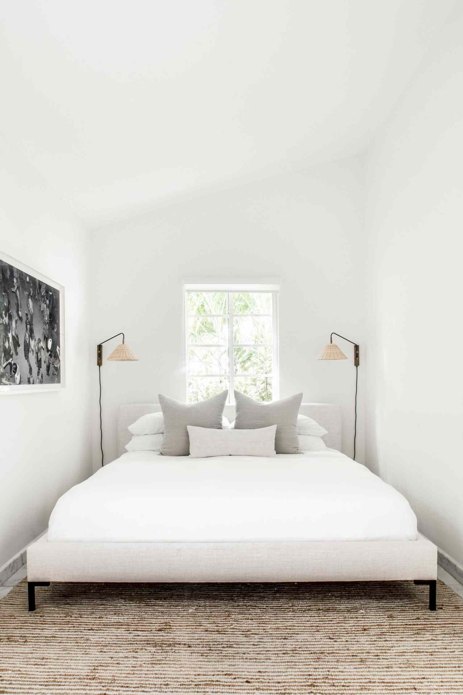 Bedroom with sconces on the wall