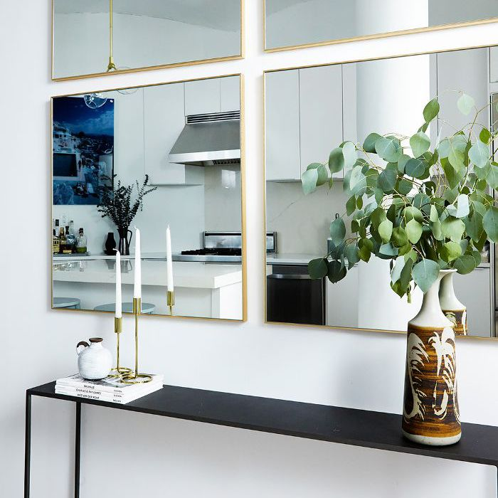 a quadrant of mirrors along a kitchen wall