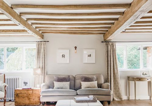 Living room with wooden beams.