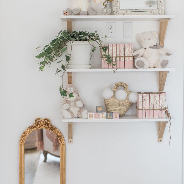 Daughter Molly's bedroom décor includes a mirror and blush colored books