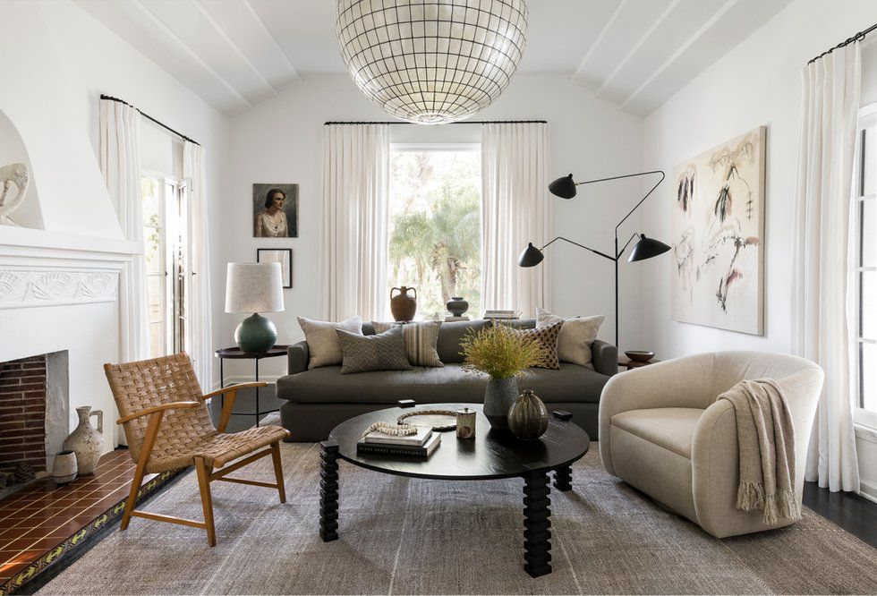 A midcentury modern living area featuring a wide variety of furniture and materials.