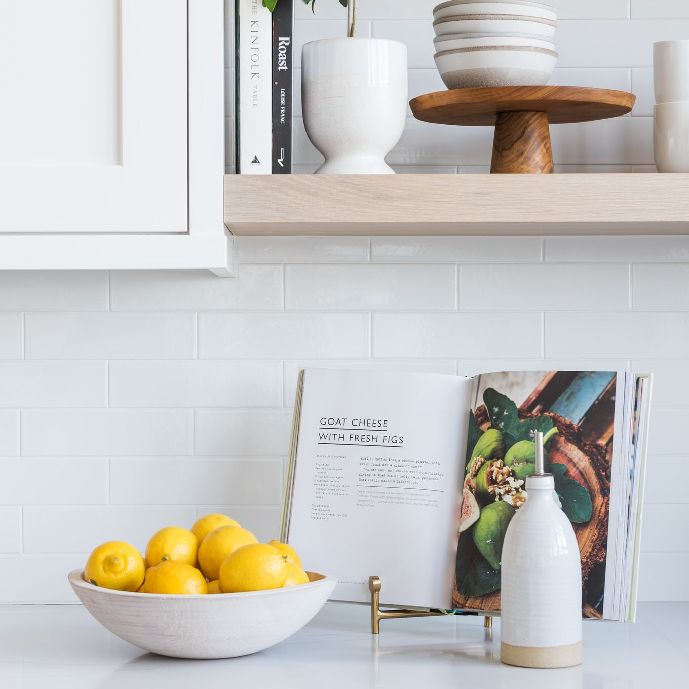 White kitchen counter with small plants.