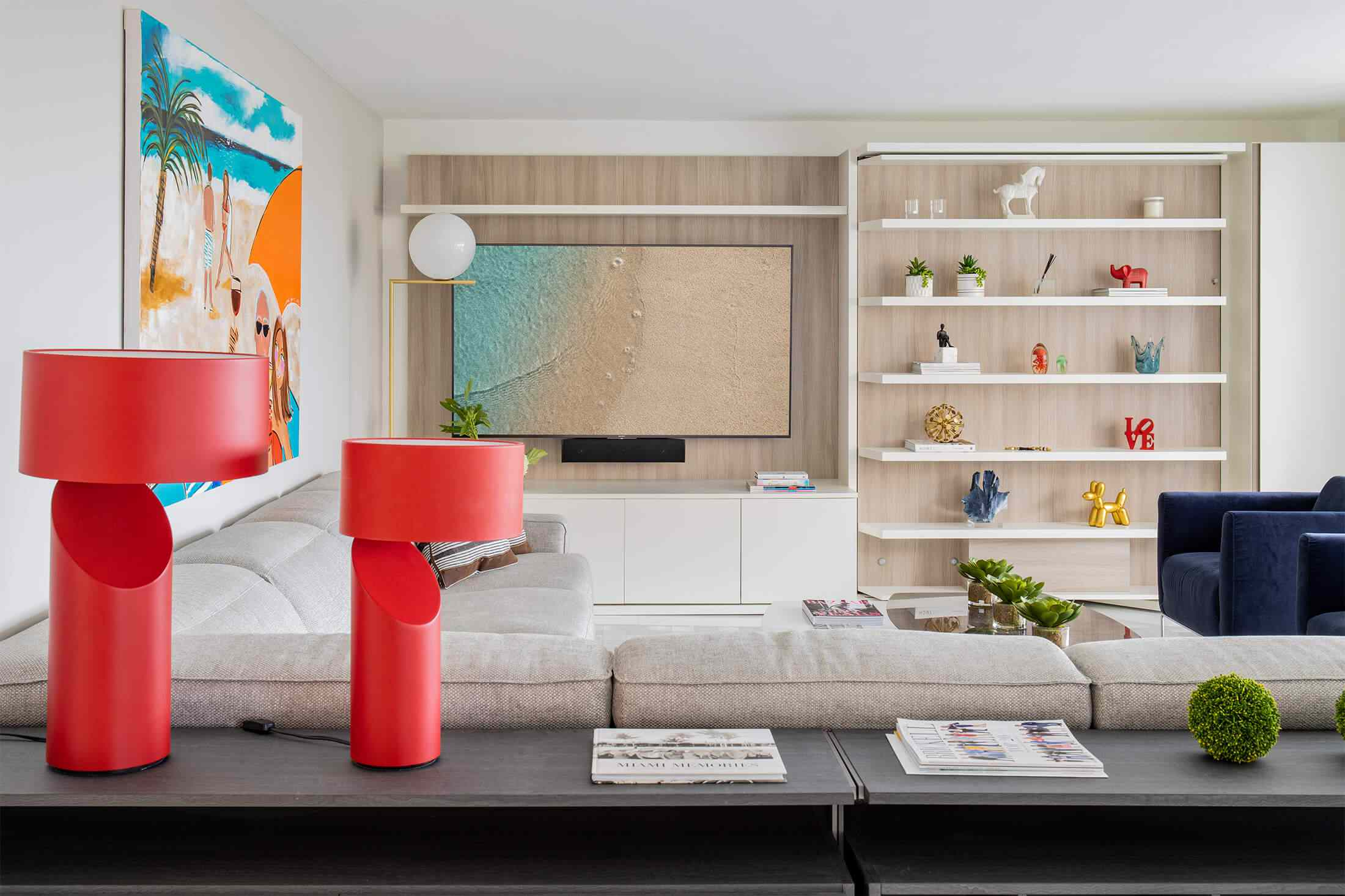 Living room with built-in media console, large colorful hanging art
