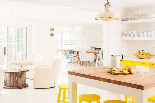 a yellow and white kitchen
