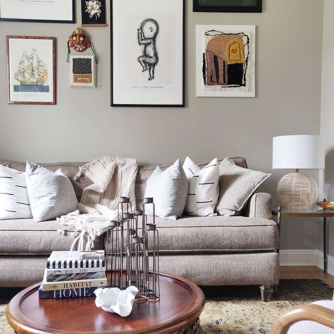 Taupe accent wall with artwork.