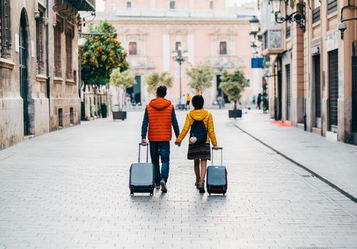 Young couple with suitcases just arriving in Valencia