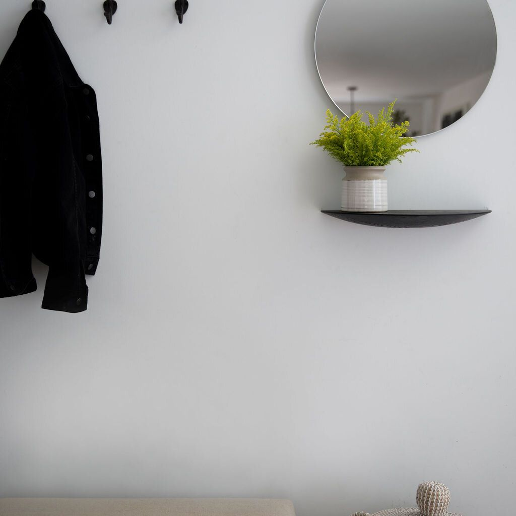 Entryway with hooks, mirror, and bench