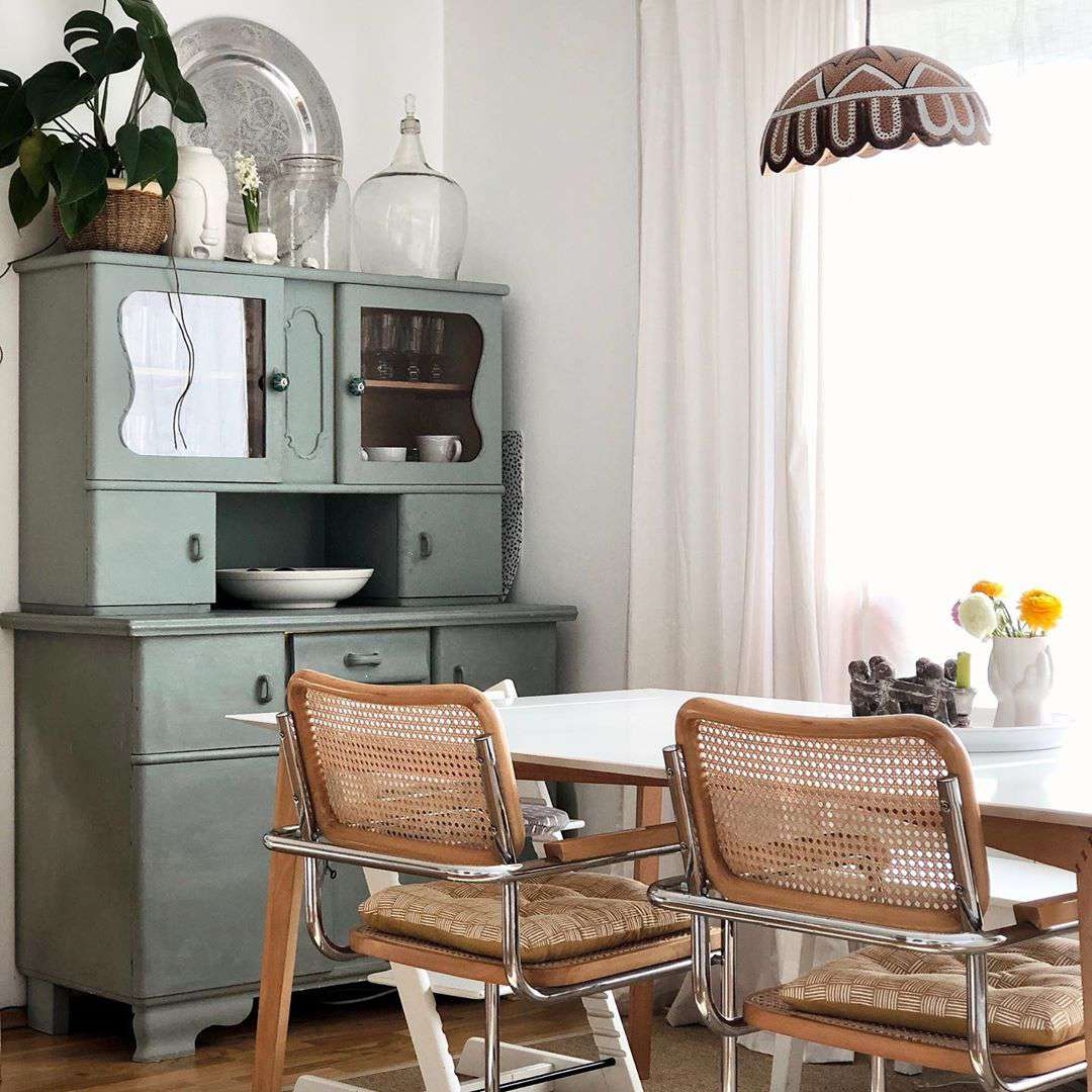 Dining room with vintage sideboard painted sage green.