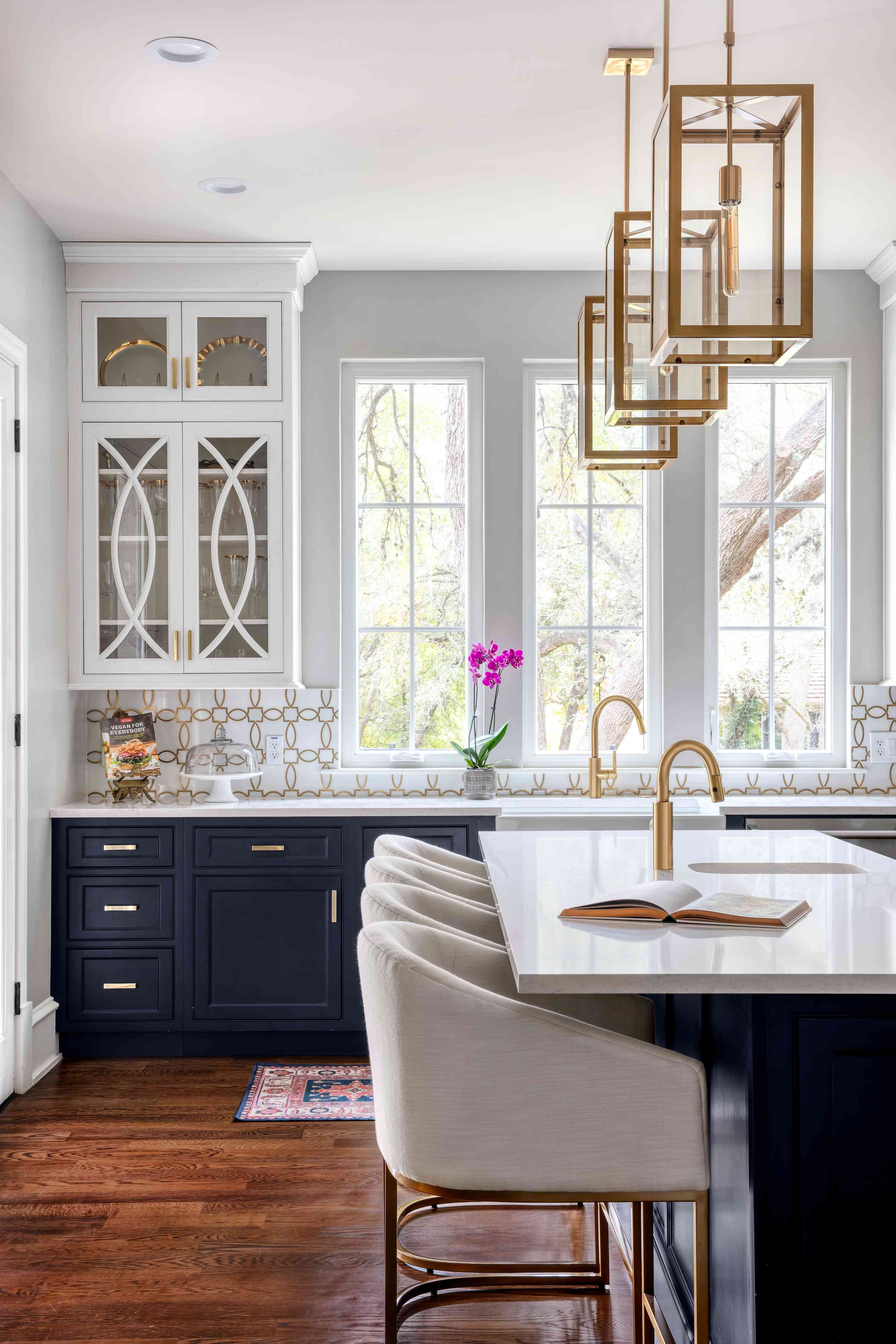 Luxe navy kitchen with gold fixtures.