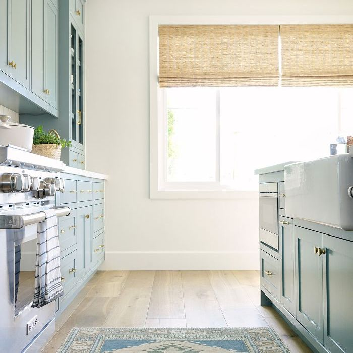 Blue cabinets and a kilim rug
