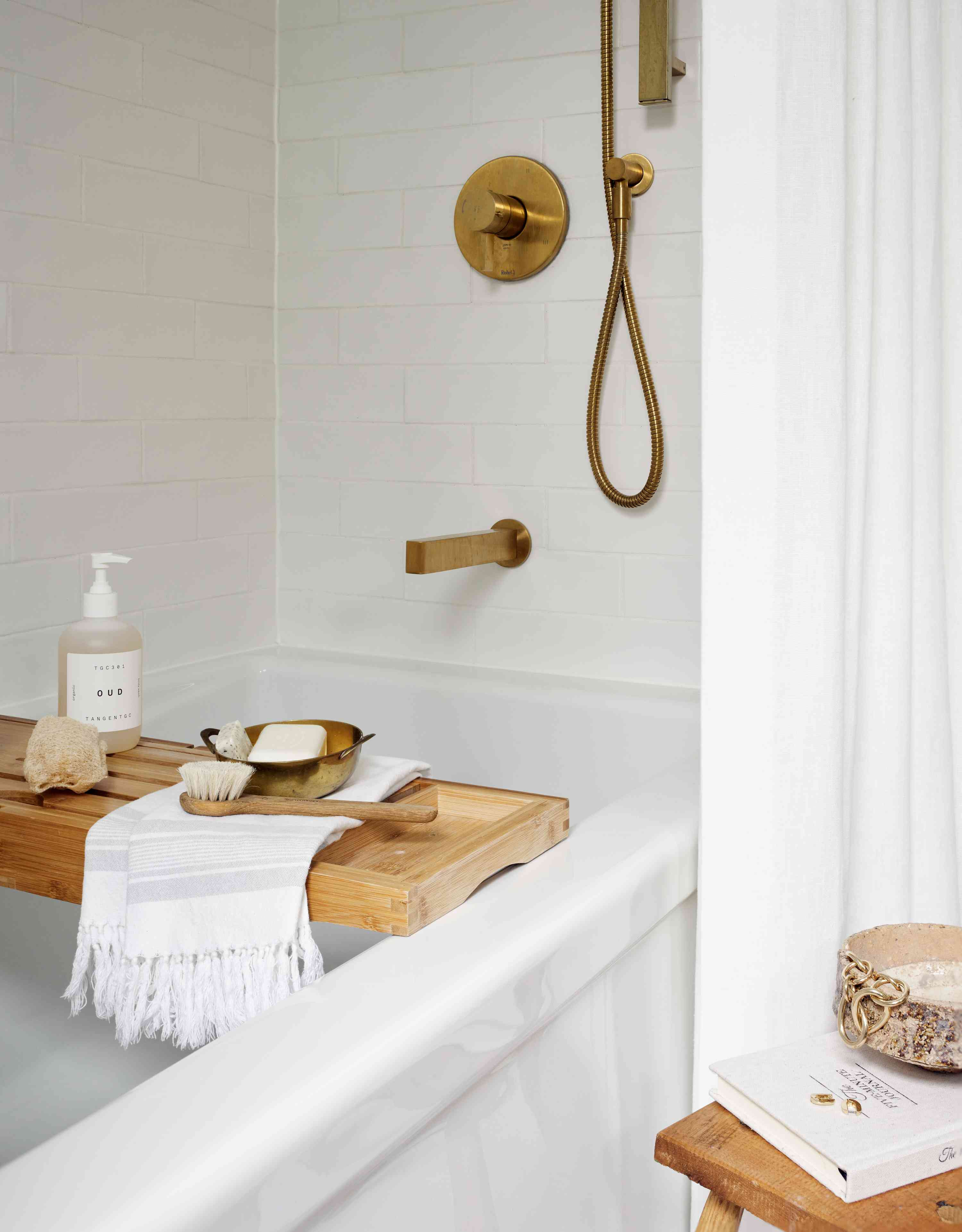 Luxurious bathtub with wooden tray.