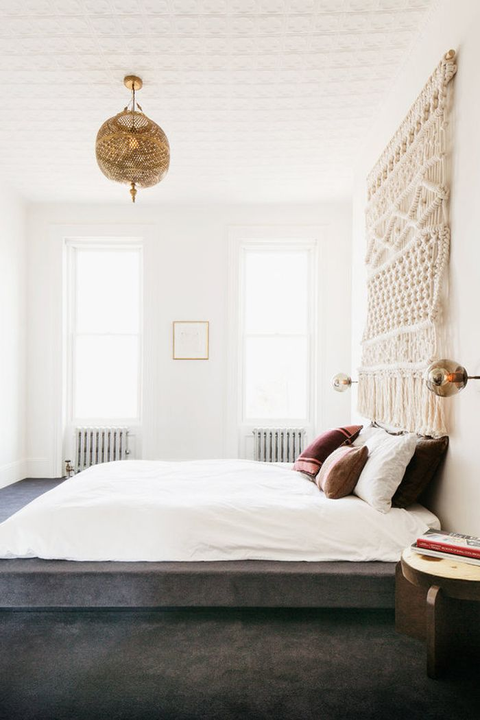Hanging artwork softens a space with eyesores like radiators and airconditioners