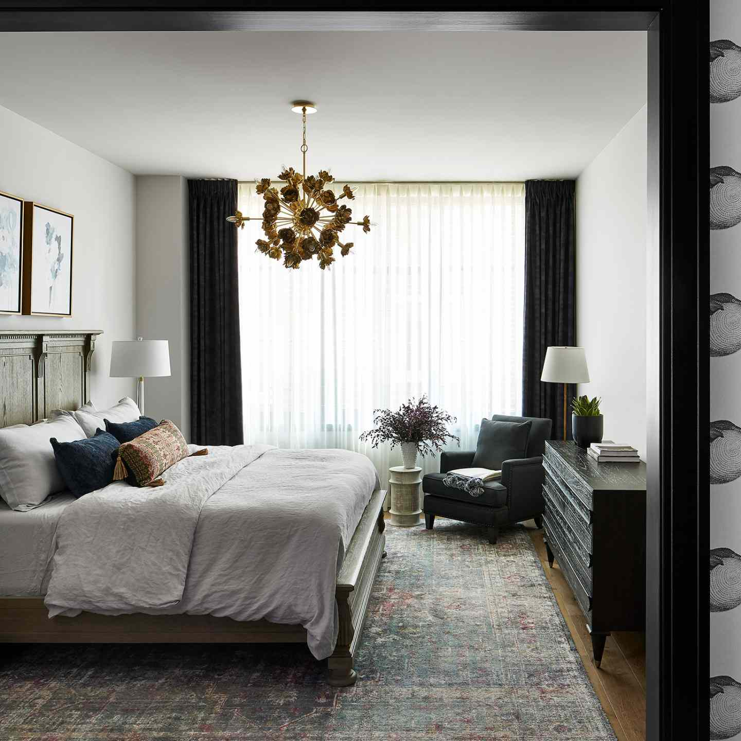 Chic upscale bedroom with pale gray walls