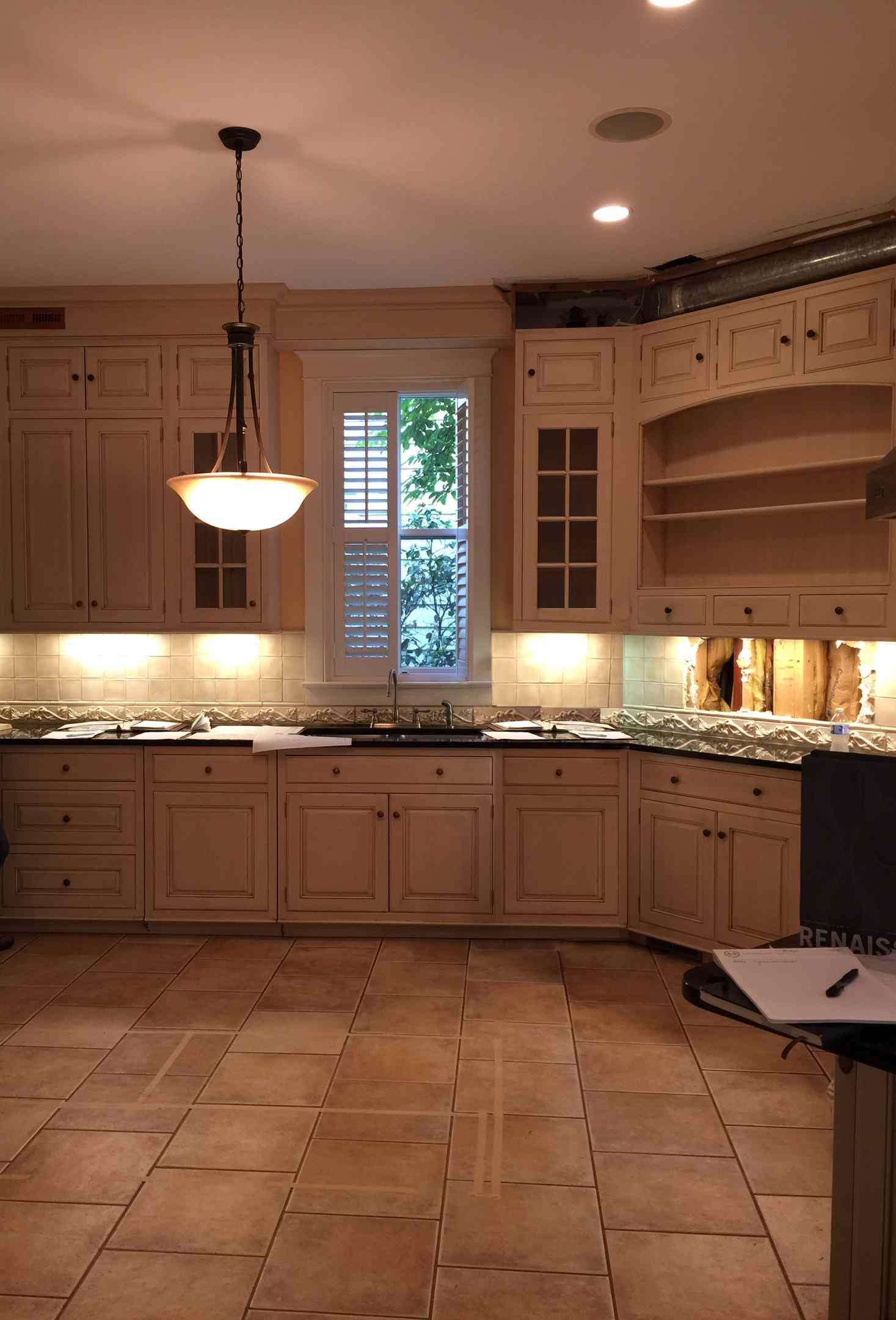 Before shot of dark kitchen.