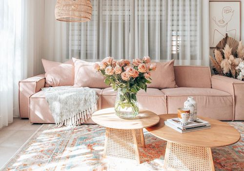Pink couch and two coffee tables.