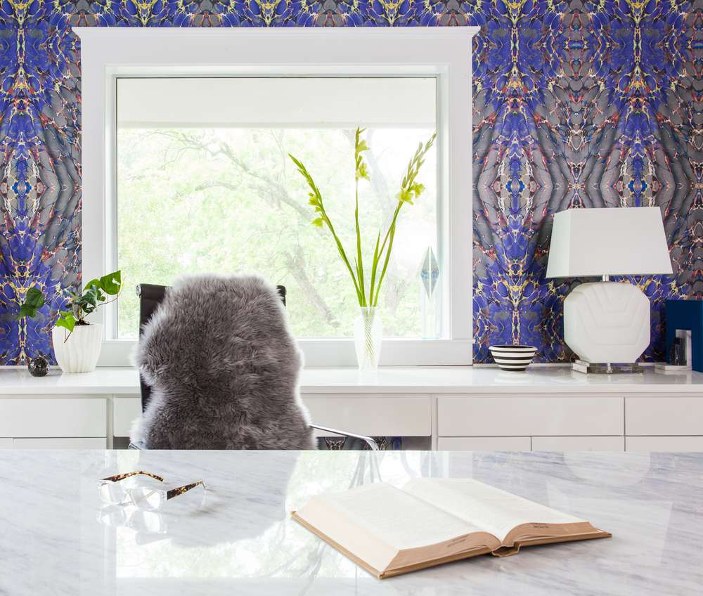 Modern home office with purple and silver Rorschach ink wallpaper