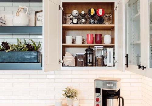 Mugs stored above a coffee maker