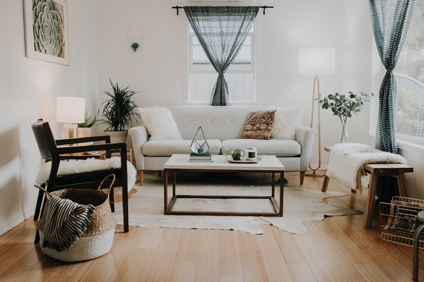 Cozy living room with sofa, armchair and wooden bench.