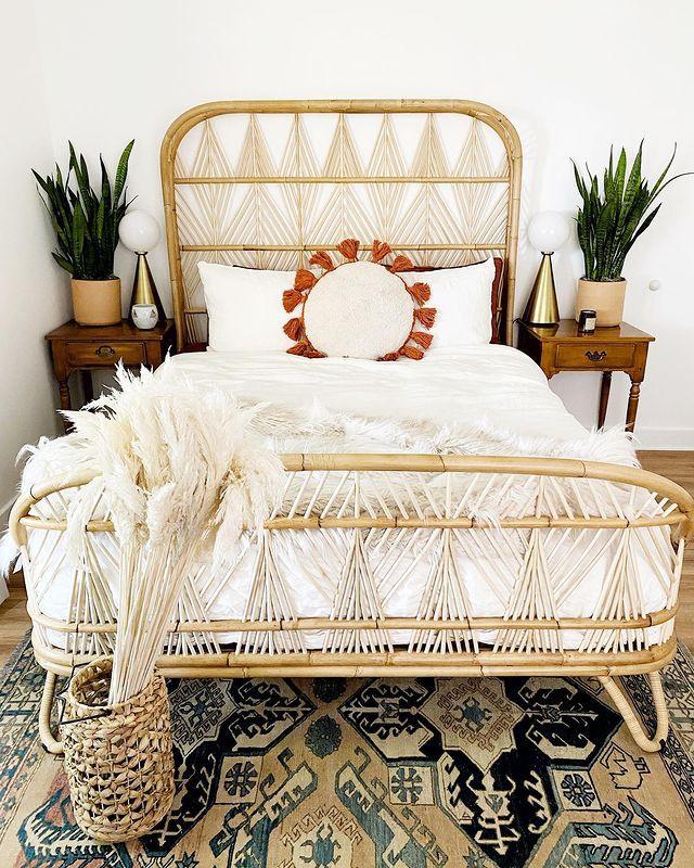 two snake plants on nightstands in a boho bedroom